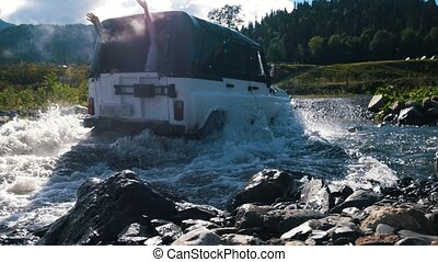 On a small river passing off-road car with passengers waving...