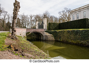 in the park there is a bridge over the pond