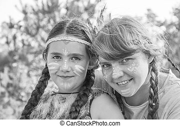 On a  sunny summer day in the forest, a little Indian girl with her mother. Black and white photo.