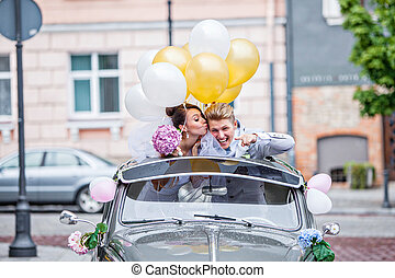 On a wedding day - Young couple in the car on their wedding ...