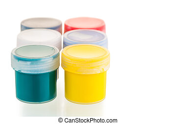 on a white background gouache paint cans close-up