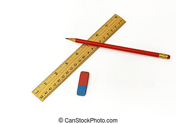 On a white background lie a ruler, an eraser and a simple pencil
