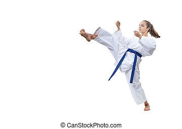 On a white background the sportswoman beats a kick leg