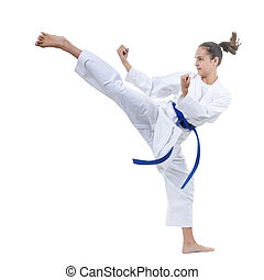 On a white background the sportswoman beats a kick