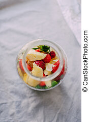 glass jar with strawberry, lemon and mint