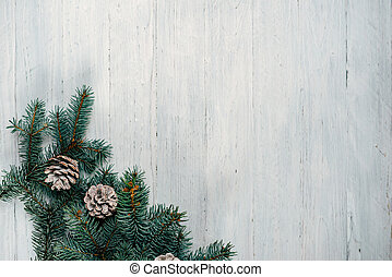 on a white wooden background Christmas tree and cones