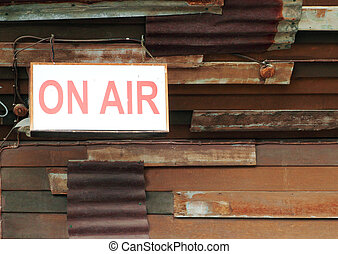 on air sign with old wall background