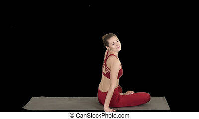 Sporty woman practicing yoga lotus pose, turning to camera and smiling, Alpha Channel