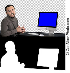 Casual businessman smiling and talking at the camera showing something on the monitor of computer, Alpha Channel. Blue Screen Mock-up Display.