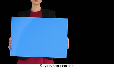Businesswoman holding blank whiteboard sign, Alpha Channel...