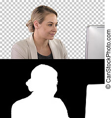 Adult businesswoman looking at computer in office, Alpha Channel