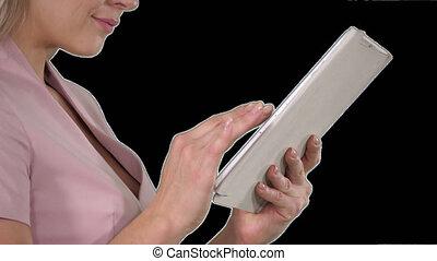 Female hands using tablet, Alpha Channel - On Alpha Matte....