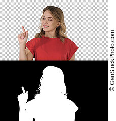 Young caucasian woman pointing with hand and finger to the side, Alpha Channel