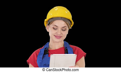 Young construction worker with tablet computer presenting...