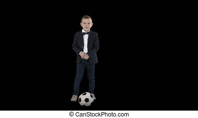 Boy in a formal suit kicking football, Alpha Channel - On...