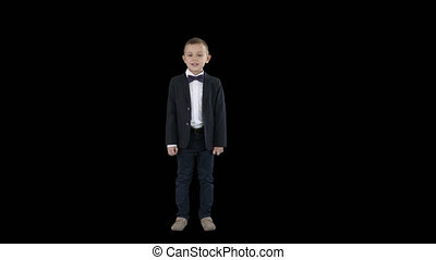 On Alpha Matte. Full lenght shot. Boy in a suit walks in a frame and starts talking, Alpha Channel. Professional shot in 4K resolution. 016. You can use it e.g. in your commercial video, education, business, presentation, broadcast