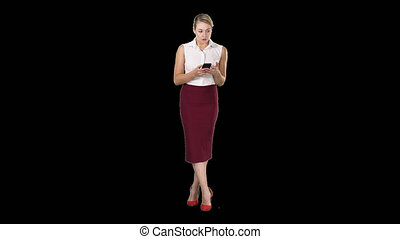 Attractive european female with smartphone in hand, touching...