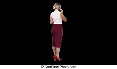 Standing young beautiful woman using a mobile phone making a call, Alpha Channel