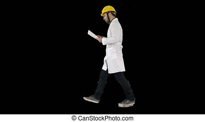 Engineer manager walking with hard hat is holding paper and checking, Alpha Channel