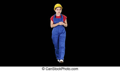 A woman construction worker talking to camera in confident way, Alpha Channel