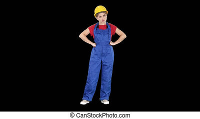 Angry woman construction worker shows fist Negative...