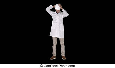 Arab engineer in white robe putting hard hat on Safety ...