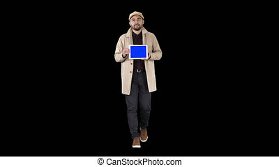 Attractive man holding tablet with blue key screen mockup,...