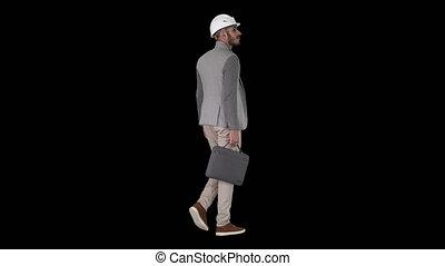 Engineer in helmet with briefcase walking, Alpha Channel -...