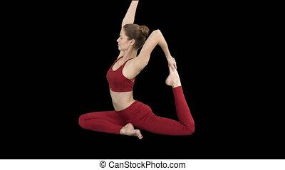 Beautiful young womandoing yoga or pilates exercise One Legged King Pigeon pose, Eka Pada Rajakapotasana, Alpha Channel