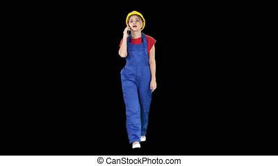 Female construction woman making a call, Alpha Channel - On...