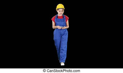 Female constuction worker counting money while walking,...