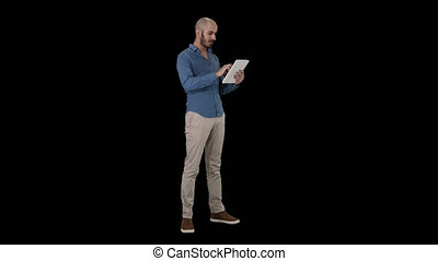 Handsome arabic business man using tablet, Alpha Channel -...