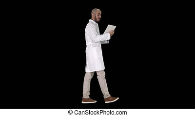 Sincere doctor making video call to his patient walking,...