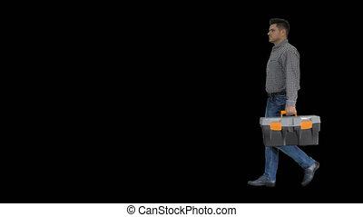 Professional repairman concept Handyman walking with tool...
