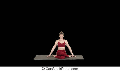 Young attractive woman practicing yoga, sitting in Gomukasana exercise, Cow Face pose, Alpha Channel