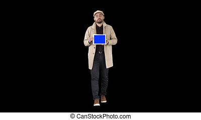 Young man walking, talking and showing digital tablet with...