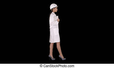 Attractive Hispanic woman in white lab coat and white safety...