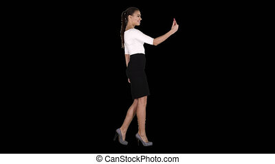 Young latin formal woman making a video call or recording video blog, Alpha Channel