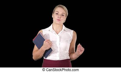 Beautiful teacher with notebooks explaining something to...
