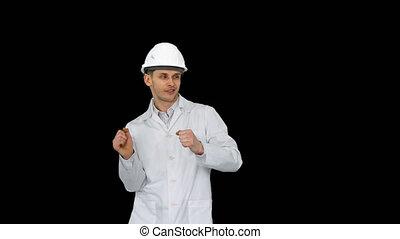Engineer man dancing in funny way, Alpha Channel