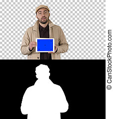 Man in trench walking and holding tablet with blue screen mockup presenting something, Alpha Channel