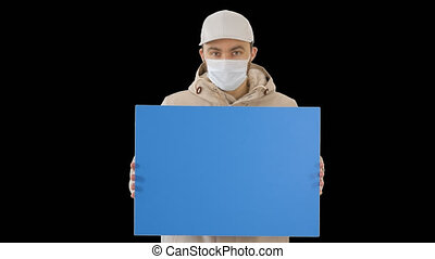 On Alpha Matte. Medium shot. Mockup blue screen. Casual man with copy space billboard wearing protective mask, Alpha Channel. Professional shot in 4K resolution. 53. You can use it e.g. in your medical, commercial video, business, presentation, broadcast