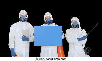 On Alpha Matte. Medium shot. Mockup blue screen. Group of epidemiologists in protective uniform holding blank placard, Alpha Channel. Professional shot in 4K resolution. 53. You can use it e.g. in your medical, commercial video, business, presentation, broadcast