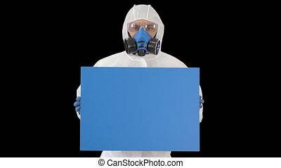 On Alpha Matte. Medium shot. Mockup blue screen. Male doctor wearing protective clothes holding blank banner, Alpha Channel. Professional shot in 4K resolution. 53. You can use it e.g. in your medical, commercial video, business, presentation, broadcast