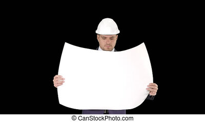 Professional architect is walking and holding blueprint The man is wearing helmet, Alpha Channel