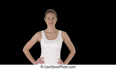 Satisfied confident active healthy woman in sports clothing...