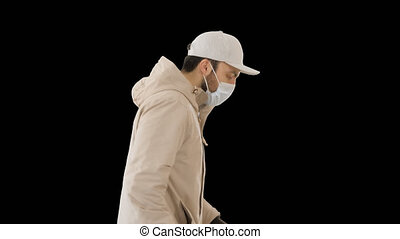 Ault man in jacket and in medical mask running, Alpha Channel