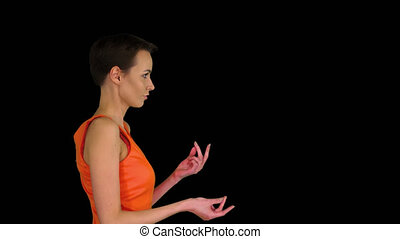 On Alpha Matte. Medium shot. Side view. Beautiful woman dances in flirty orange dress, Alpha Channel. Professional shot in 4K resolution. 023. You can use it e.g. in your commercial video, business, presentation, broadcast
