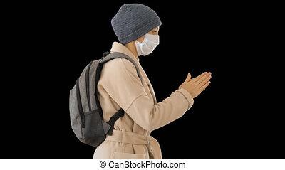 Blonde woman in medical mask during quarantine period using ...