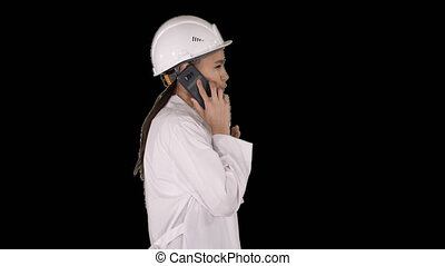 Female science engineer making a call while walking, Alpha Channel